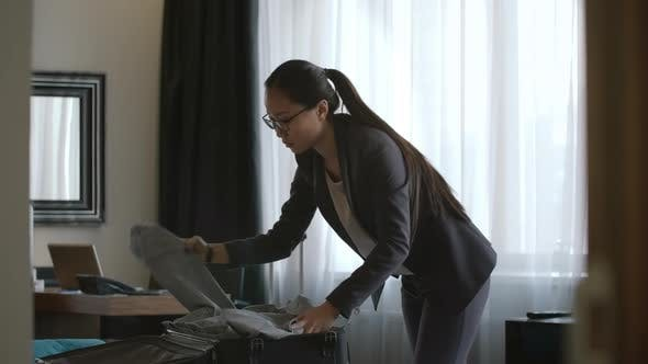 Thumbnail for Businesswoman Packing Suitcase in Hotel Room