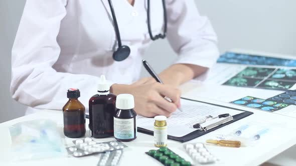 Doctor Prescribes A Prescription For Antibiotics