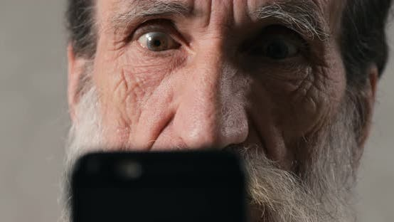Cover Image for Senior Man Is Shocked with Smartphone