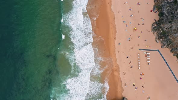 Thumbnail for Aerial Steady Footage of Praia Da Adraga Beach. White Atlantic Ocean Waves Rolling Towards Sandy