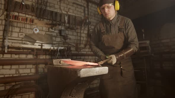 Thumbnail for A Man Blacksmith Forging a Knife with Twisted Handle - Putting It in the Furnace for Better Heating