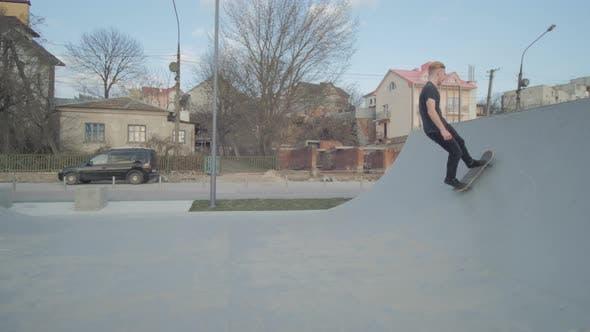 Teens in a skateboard park