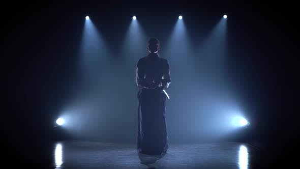 Aikido Master Technique Demonstration With Japanese Sword Katana Silhouette On Black Studio By Kinomaster On Envato Elements