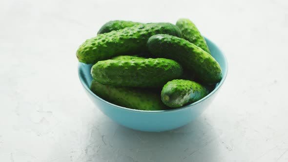 Thumbnail for Bowl of Green Shiny Cucumbers