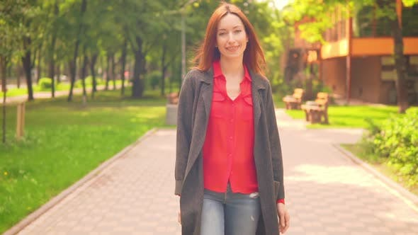 Thumbnail for Beautiful Young Woman with Red Hair Stroll Outdoors