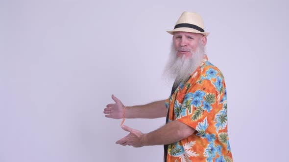 Thumbnail for Happy Mature Bearded Tourist Man Showing Something