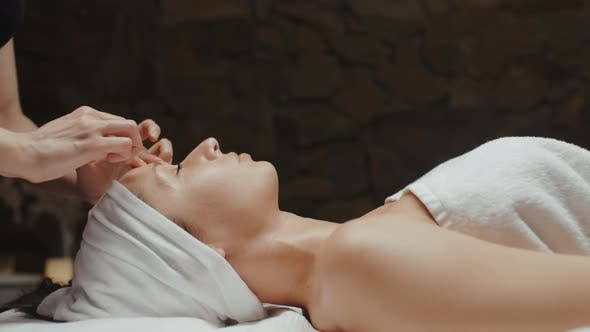 Cover Image for Woman Receiving Facial Massage in Spa Wellness Skin Care, Face Treatment, Rejuvenation Procedure