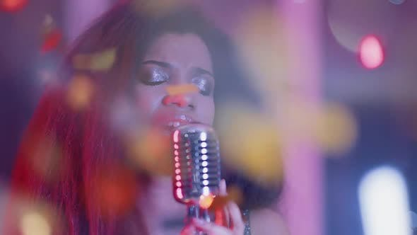 Luxury Party Portrait of a Young African Female Singing in a Nightclub Closeup of a Woman's Face in