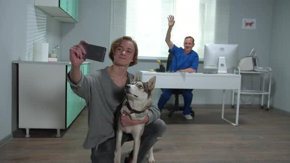 Slow Motion, Man with Husky Makes a Selfie with Vet and Dog