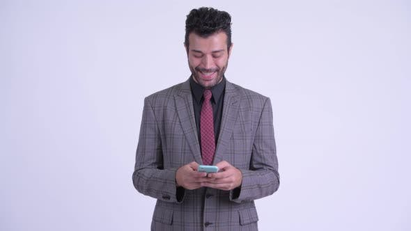 Thumbnail for Happy Bearded Persian Businessman Using Phone