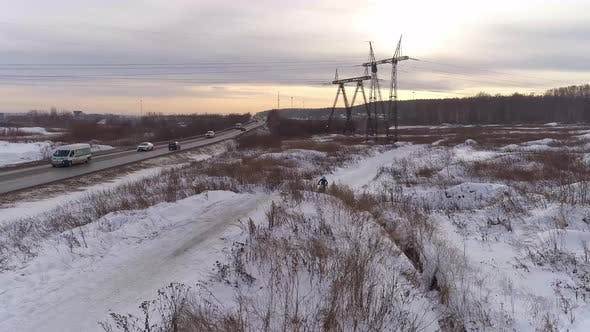 Aerial view of Racer motorcycle rides on motocross snowy track in winter 01
