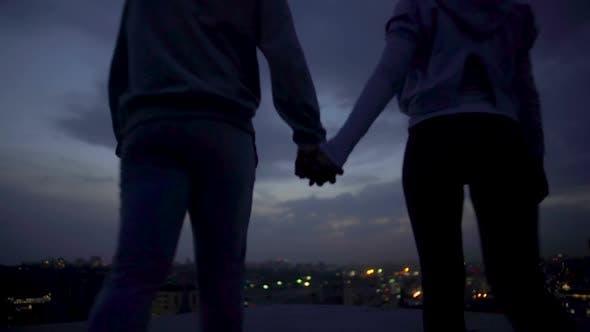 Thumbnail for Young Husband and Wife Enjoying Moments of Solitude Illuminated City at Night