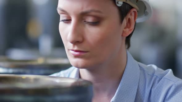 Thumbnail for Female Factory Supervisor Checking Product