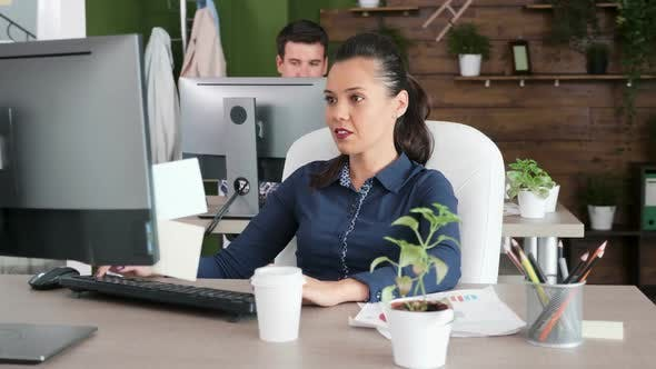Thumbnail for Focused Young Female Entrepreneur Typing on Her Computer
