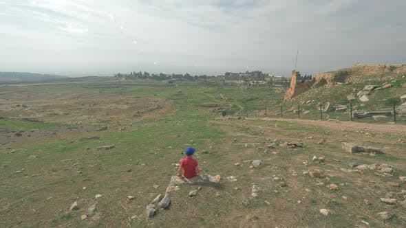 Thumbnail for Child Looking at Ruins of Ancient City Hierapolis in Pamukkale, Turkey
