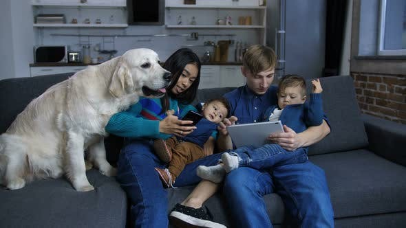 Thumbnail for Mulit Ethnic Family with Pet Dog Resting on Sofa