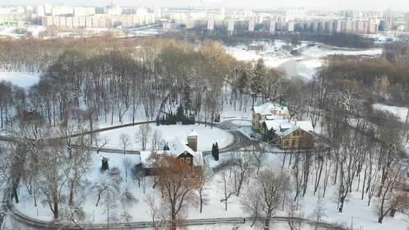 An Island on a Lake with a Bridge in the Winter Loshitsky Park