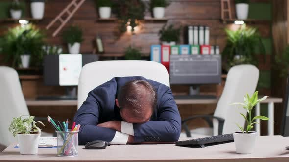 Thumbnail for Businessman Sleeping with His Head on the Desk