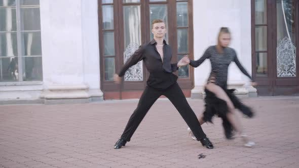 Thumbnail for Wide Shot of Confident Couple Performing Paso Doble in Urban City