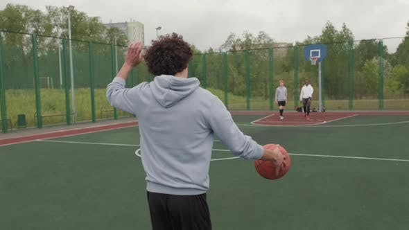 Guys Meeting on Outdoor Basketball Court to Shoot Hoops