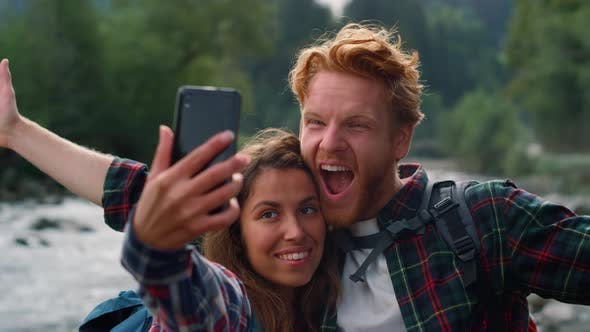 Man and Woman Taking Selfie on Phone