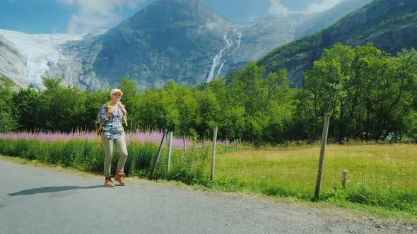 Thumbnail for The Woman Admires with Admiration the Beautiful Nature of Norway