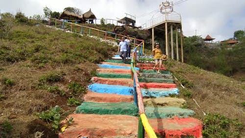 Travel from the top of the colored stairs
