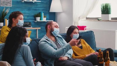 Mixed Races of Friends Looking at Tv Man Holding Remote Control