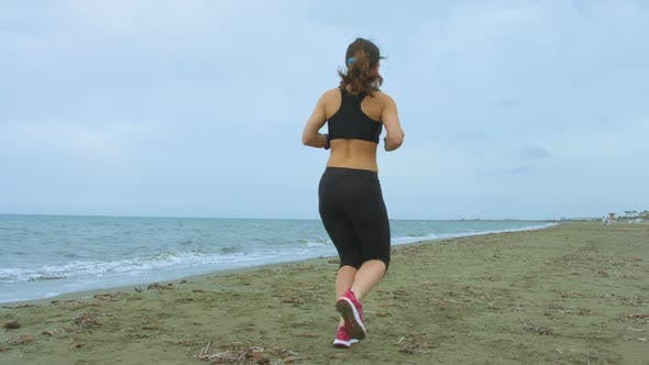 Thumbnail for Young Brunette in Sportswear Jogging in the Morning. Healthy Outdoor Activities