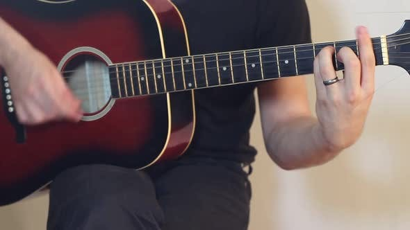 Thumbnail for Musician Plays A Guitar