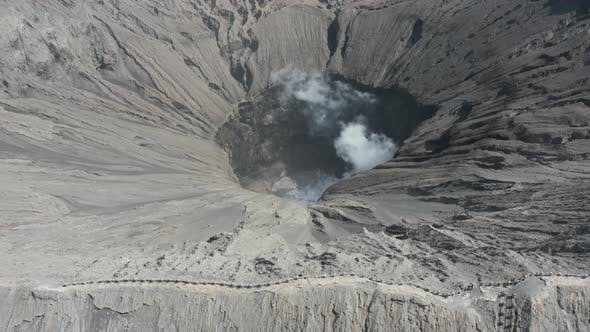 Thumbnail for Aerial drone view of steam and gas from an active volcano