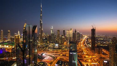 Day to Night Timelapse of Dubai City Center with Modern Tall Skyscrapers and Busy Street Traffic on