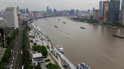 Shanghai River Cityscape Pan Up