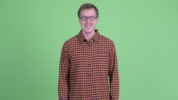 Thumbnail for Happy Young Hipster Man Smiling with Arms Crossed