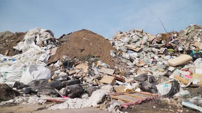 Big piles of garbage. Empty bottles, plastic in the waste dump. Pollution concept. Garbage heap