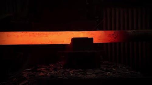 Hot Metal Iron Ingot into the Hammer Press.