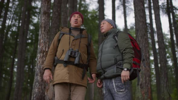 Thumbnail for Two Senior Hikers Discussing Route in Forest