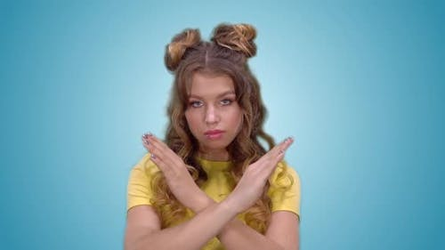 Attractive Young Girl in Yellow Shirt Showing Ban Gesture