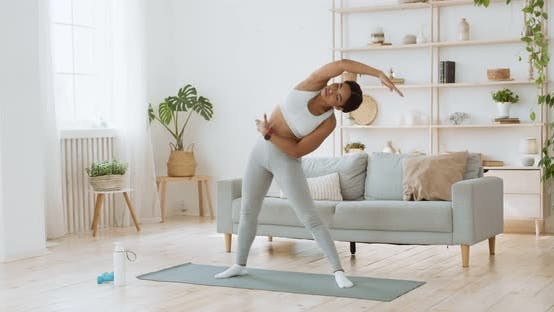 Thumbnail for Young Yogi Black Lady Tilting Her Body To Sides at Home, Slow Motion