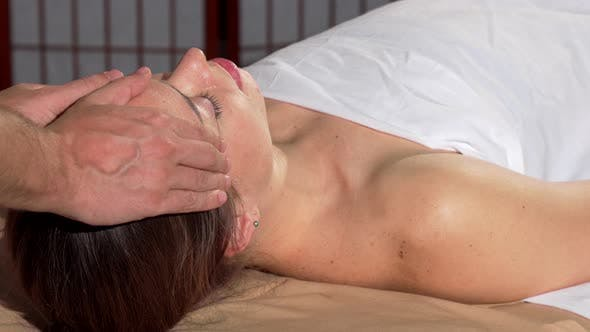 Thumbnail for Woman Receiving Relaxing Head Massage at Spa Center