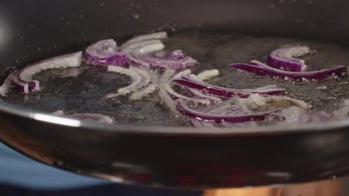 Fry Onions In Oil In A Pan
