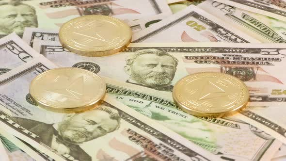 Gold Tron Coin TTX Coins Rotating on Bills of 50 Dollars. Worldwide Virtual Internet Cryptocurrency