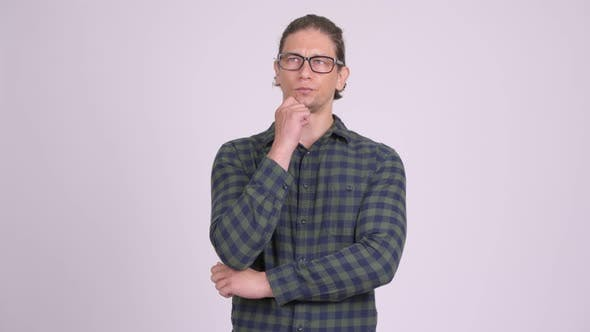 Thumbnail for Handsome Hipster Man Thinking and Looking Up