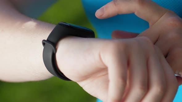Thumbnail for Hands of Fat Woman Runnner Using Fitness Bracelet