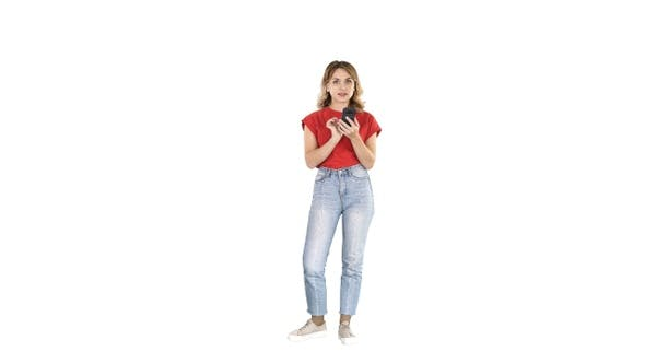 Cover Image for Smiling teen girl text messaging on her mobile on white background.