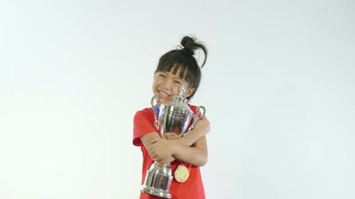 Little Girl With A Champion Cup