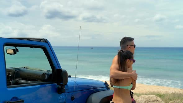 Thumbnail for Caucasian couple embracing each other on the beach 4k