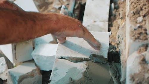 Construction Worker or Mason Laying Bricks and Creating Walls. Bricklayer Laying Bricks To Make a