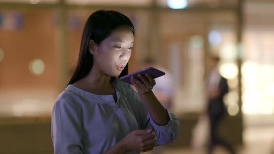 Thumbnail for Woman check on cellphone at night
