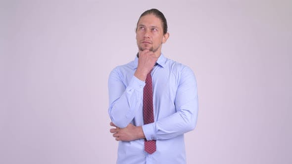 Cover Image for Handsome Businessman Thinking with Various Emotions